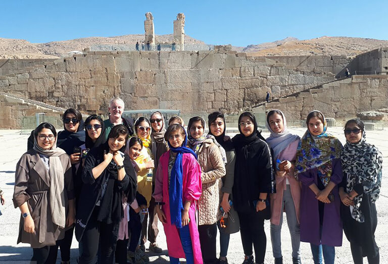 A group of student took a picture with tourists from Northern Ireland in Persepolis