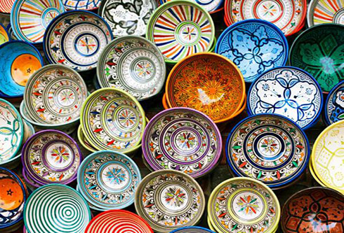 The history of pottery in Iran dates back to long years ago, confirmed by the thousand samples kept in Iran museums. This kind of handicraft is mostly made in cities like Lalejin and Meybod, yet in almost all cities of Iran, you can find the track of them in the shops that sell dishes, mugs, and ceramics. These artworks are designed in different colors and patterns, from traditional to modern ones; whichever it is, they can bring all the memories back from the trip to Iran.