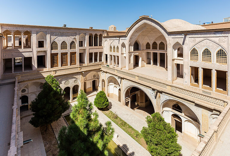 An exterior view of the Abbāsi House and its central courtyard, Kashan